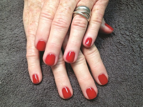 She was an early adopter of CND's Vinylux and was happy to get my report two weeks later that my manicure had held up well through my travels.