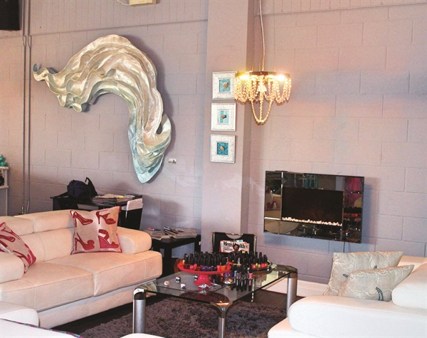 <p>A&nbsp;seating area at Posh in the Port features a more subdued decor than its sister salon, Posh Pedicure Lounge, while still incorporating signature pink and leopard prints.</p>