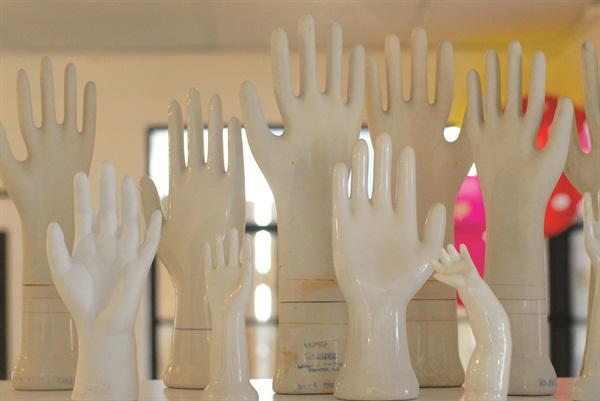 This collection of antique porcelain hands complements the salon's commitment to nails-only services.