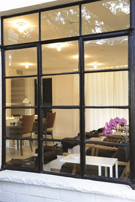 <p>Because Polish's space was originally a home, its large mid-century modern windows are designed to let in plenty of natural light.</p>