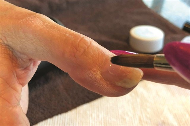 When using acrylic, pick up a little less product than you think you need, advises nail tech Guin Littlefield.