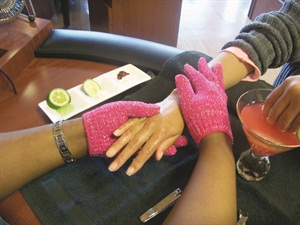 <p>Place your client's hands in a martini glass filled with cranberry soak, red food coloring, fresh lime slices, and Epsom and rock salt.</p>