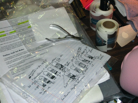 <p>Lammers sketched her black-and-white acrylic nails before she applied them at the competition in Orlando, Fla.</p>