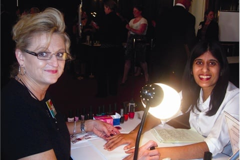 "<p>At Welcome to Our World, I got a manicure from Shirley Schote, an account manager with OPI. ""I started out as a nail tech, and I like to give back,"" Schote said. ""We're here to show what the beauty industry is all about.""</p>"