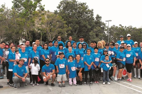 "<p class=""NoParagraphStyle"">A.I.I. employees take a stand at the EIF Revlon Run/Walk.</p>"