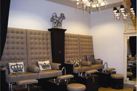 "<p>The pedicure area is tucked away in the back of the salon allowing technicians to lower the lights during services. Vanessa Ginder Dinkel, co-owner and manager, called the pedicure area ""a good massage turf"" for the reflexology specialty service.</p>"
