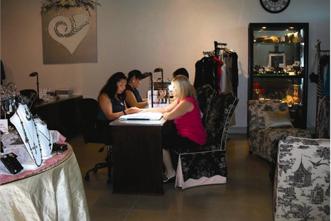 <p>Open for more than a year, Diva is looking to offer classes and training to its technicians, but for now they learn from each other. Pictured are four of the manicurists. (Maria Laursen and Lisa McFall give Andrea Packey and Lori Adams manicures.)</p>