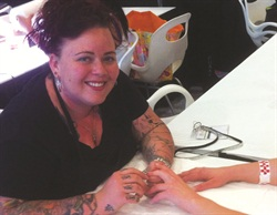 <p>Air-conditioning leaves Amanda Lenher's clients with cold hands so she rests them on warming mats during nail services.</p>