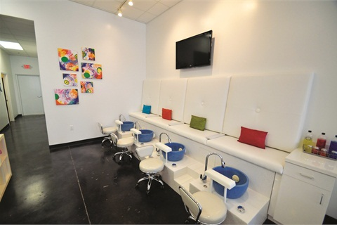 White pedicure benches allow the accent colors to truly pop.