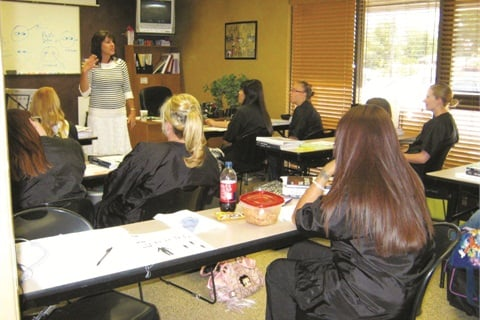 <p>Color My Nails School of Nail Technology brings in guest speakers, such as this woman who is sharing information on body language and how to build your nail business, and invites both current students and alumni to these continuing education classes.</p>