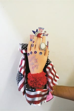 At Royal Beauty School, students enrolled in the nail program learn 3-D nail art and even participate in in-house competitions to improve their skills. This is the winning design from the school's Fourth of July Nail Art Competition.