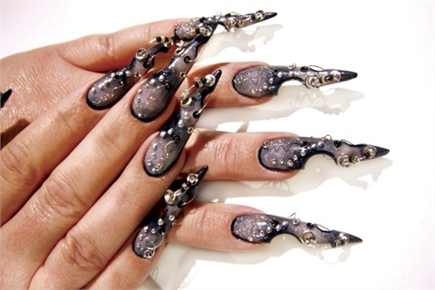 An Example Of Bakers Exquisite Nail Embellishment Designs Incorporating Color Fades 3 D Art And Asymmetrical Stiletto Sculpts