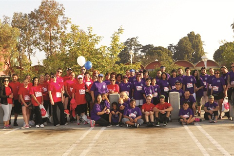 <p>A.I.I. employees gather for a group photo at the Revlon Run/Walk 2013.</p>