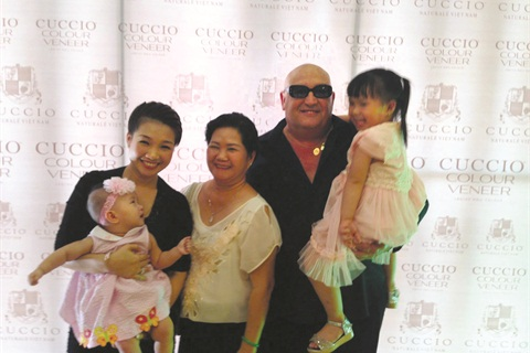 <p>Tony Cuccio poses with Kelly Pang's family.</p>