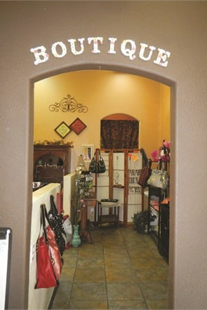 """<p>The retail area at Marsilio & Co.Salon includes a """"boutique"""" room fullof purses, jewelry, and scarves.</p>"""