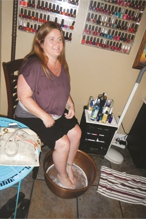 "<p>I had a quick foot soak in this copper pedicure bowl before jumping up in the comfortable facial chair for my ""It's Not Just a Pedicure"" service.</p>"
