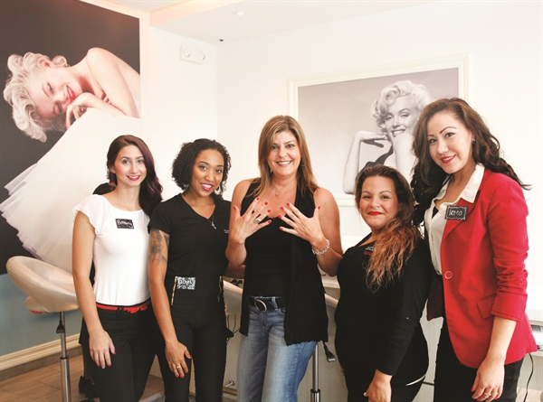 <p>Left to right: Brittany Avallone (manager), Rachel Craine (nail tech), me in the center showing off my nails, Jesel Rios (nail tech), and Irma Bijarro (general manager).</p>