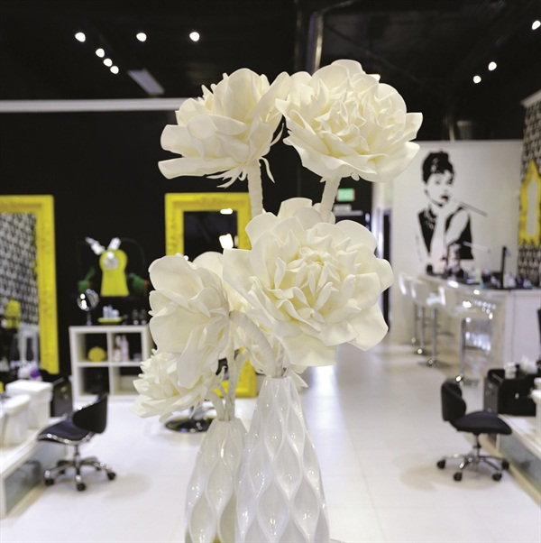 <p>Audrey Hepburn wall art adds class to Laqué's upscale bar theme.</p>