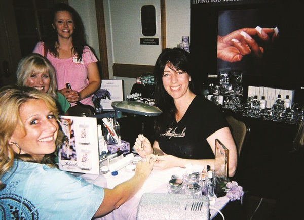 <p>Amy Becker demonstrates her Masterworks line.</p>