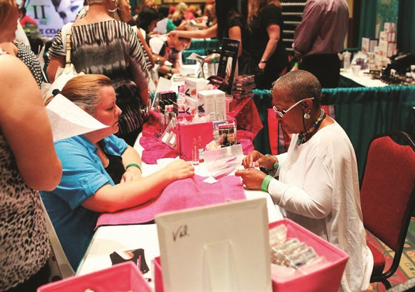 <p>The Dashing Diva booth features educator Val Clark.</p>