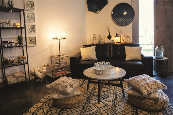 <p>Couches, pillows, cushions, a rug, and mint water help guests relax while waiting for their service.</p>