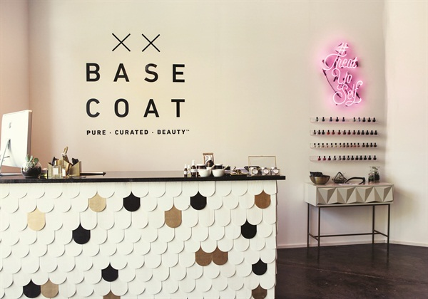 <p>The cash wrap was designed and built by Rust and Varnish. The theme was inspired by Tran's love of black, white, and gold with pops of neon color. The vibrant #TreatYoSelf neon sign was custom made.</p>