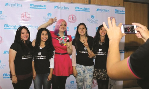 <p>Event organizer Heidy Aristizabal (center) poses with her students.</p>