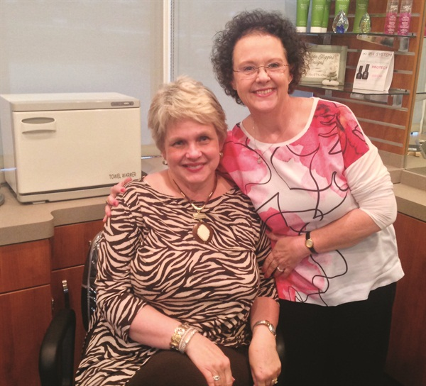 <p>When she can't make her standing appointment, Marsha Chambers (left) expresses her regrets to nail tech Susan Higgins in verse.</p>