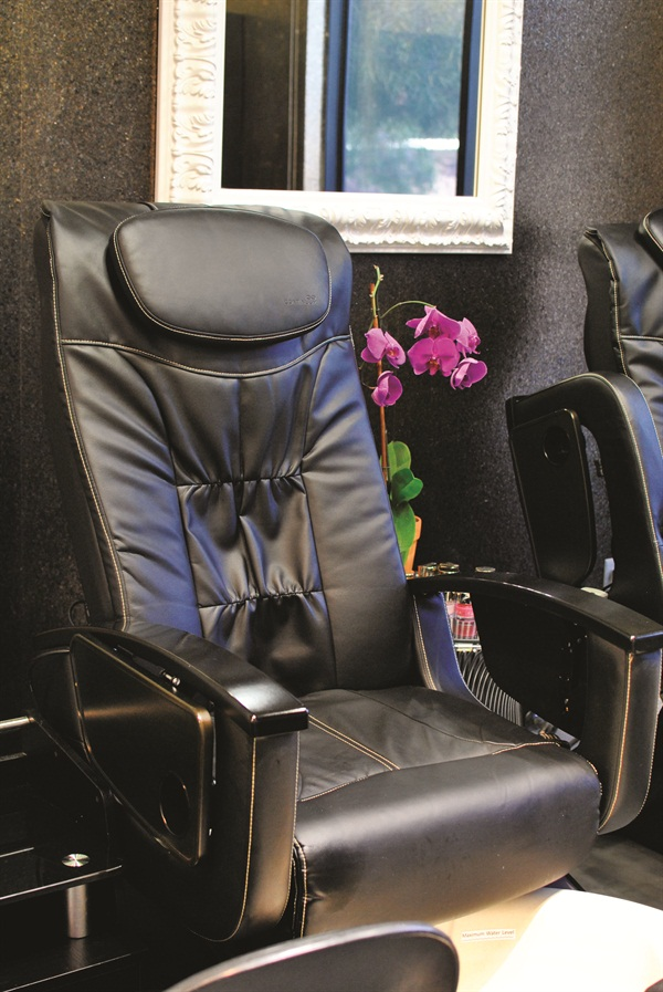 A curtain is in place to divide the pedicure area if it makes a client feel more comfortable.