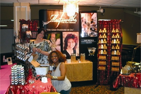<p>Amy Becker (left) and Kira Frazier set up the Masterworks by Amy Becker booth.</p>