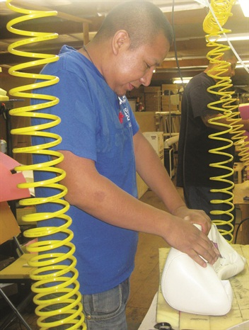 <p>ose Garcia is one of the U.S.'s few remaining skillful upholsterers; here, he stitches a chair for Belava at the company's Southern California office-factory</p>
