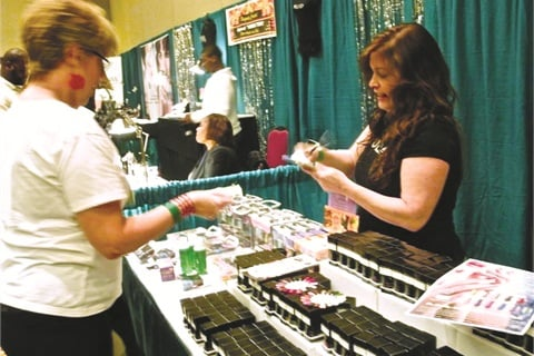 Nubar educator Michelle Aab helps a nail tech make product purchases.