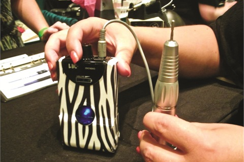 """<p class=""""NoParagraphStyle"""">Check out the cute zebra-striped electric file at Erica's Advanced Technical Abrasives booth.</p>"""