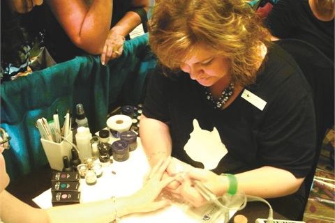 """<p class=""""NoParagraphStyle"""">Young Nails' Teresa Carter is hard at work demoing.</p>"""
