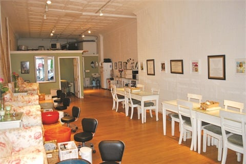 The interior of the salon features sixpedicure stations, four manicure spots,and one facial and massage room.