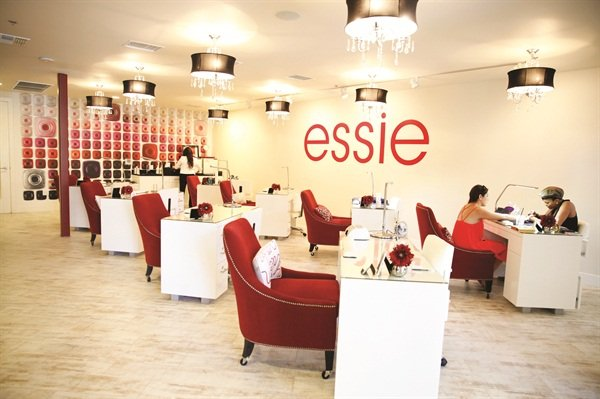 A wall featuring some of Essie's 300 polish colors is the perfect backdrop to the eight manicuring stations.
