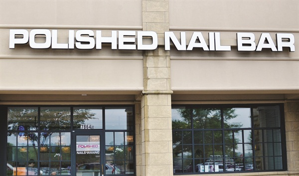 <p>The bold white Polished Nail Bar logo is hard to miss.</p>