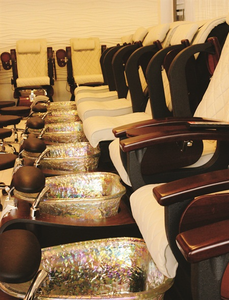 <p>Rows of pedicure thrones await customers.</p>