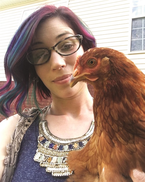 Jana Warnke poses with Rue.b after her beak healed.