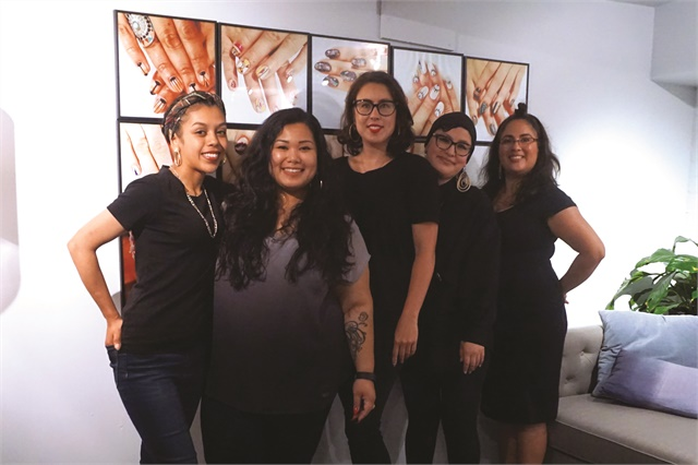 All of the nail techs specialize in nail art. That's owner Mia Rubie in the center.