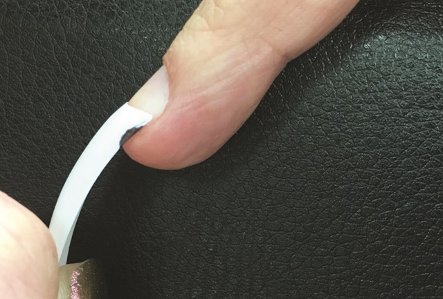 "The shaded spot indicates where you could file a small ""saddle"" for the tip to rest over the bulge of skin on a bitten nail."