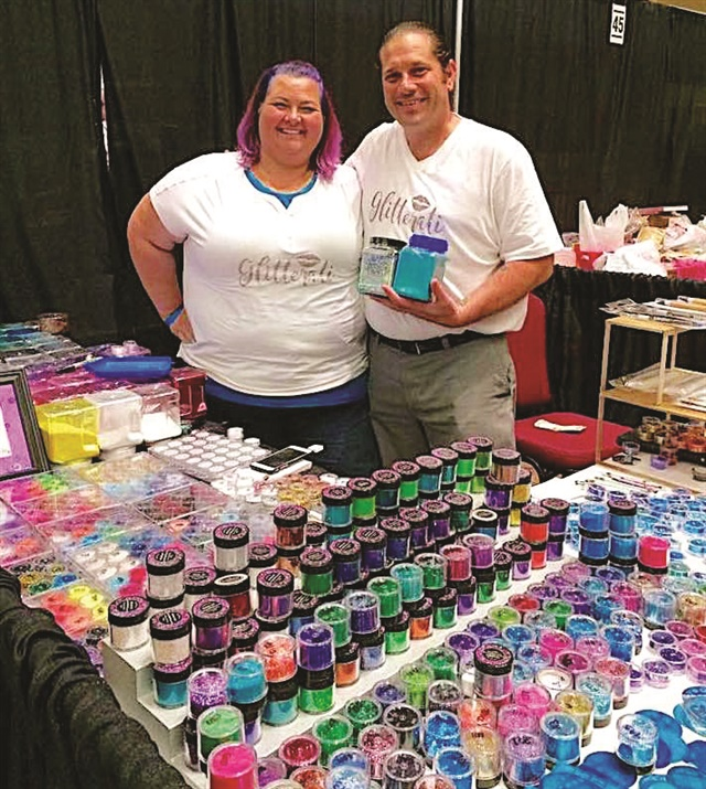 """<p>Glitterati Beauty Supply owners Pamela and Doug """"The Glitter Guy"""" Balbas are happy to show off their wares.</p>"""