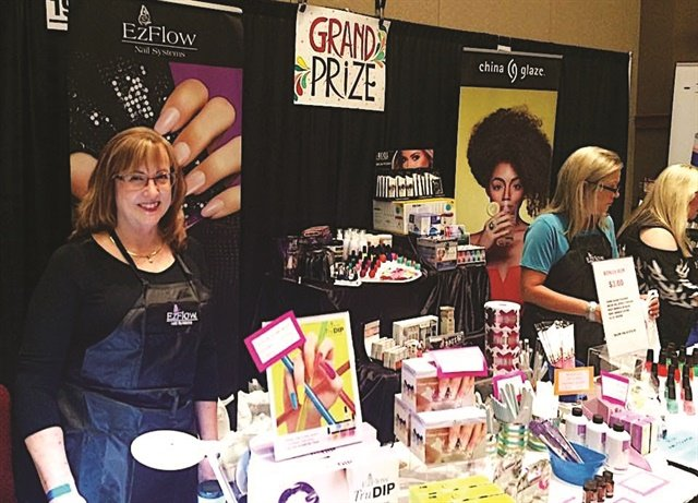 <p>Educator Michele Baker (left) is seen here at the AII booth.</p>