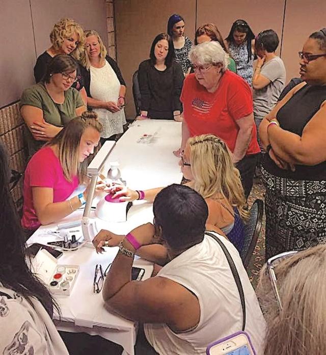 <p>Educator Hannah Lippke leads Light Elegance's free event day class.</p>