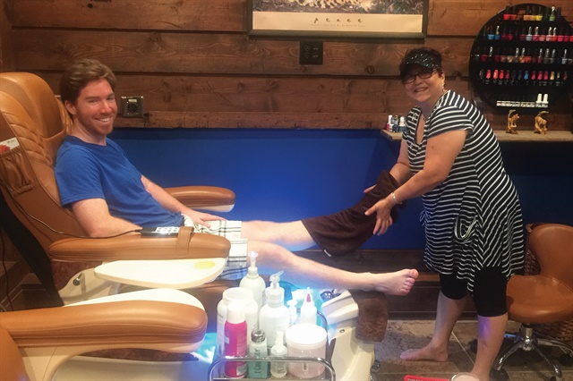 "Manicurist Lee Higgins pampers a pedicure client. Apparently, the ""barefoot"" rule applies to staff as well."
