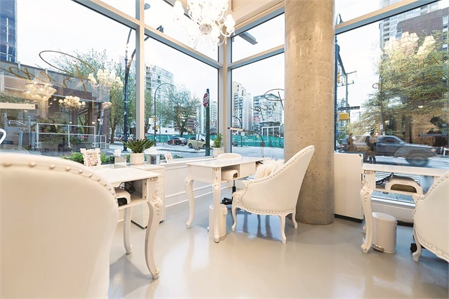 Located on a busy corner of the West End of Vancouver, the salon's large windows allow nearby drivers and pedestrians to see the decor inside.