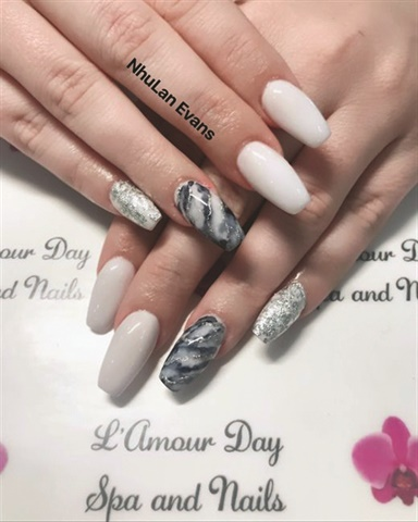 A step-and-repeat creates a consistent, branded background for nail photos. (Nails by NhuLan Evans.)