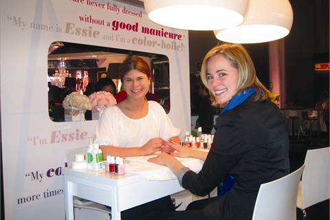 The author, celebrity manicurist Julie Kandalec (left), works the Essie booth at New York Fashion Week in February 2011.