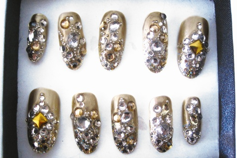 <p>Some of Kandalec's favorite nails were these for <em>Russian Vogue</em>, which were gold foil and encrusted in Swarovski crystals.</p>