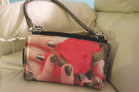 "<p class=""NoParagraphStyle"">This bag features Minx Gold Lightning Cheetah on one side and gel-polish with Minx Naja-Jovan over it.</p>"